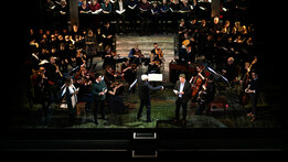Conductor with orchestra, soloists and choirs